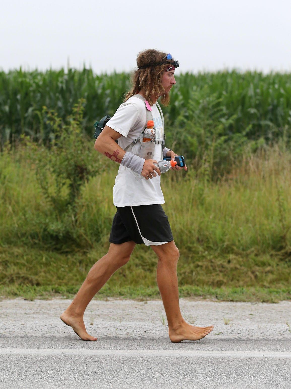 Jake Brown runs toward Avilla on Historic Rt. 66 on