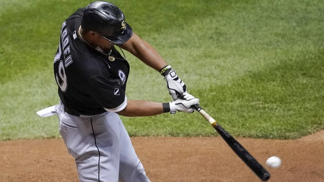 Chicago White Sox's Jose Abreu hits an RBI single during the seventh inning of a baseball game against the Milwaukee Brewers Tuesday  in Milwaukee.