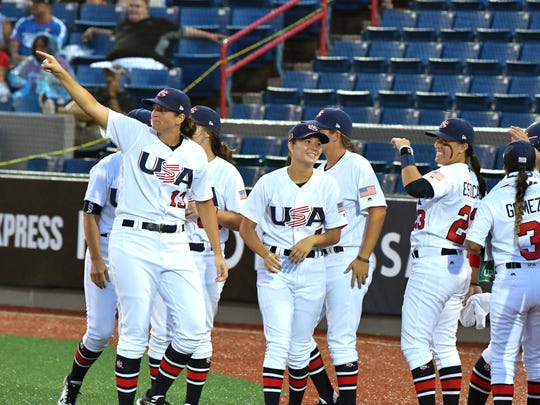 Opening night USA vs.Puerto Rico at the WBSC Women's Baseball World Cup. A storm and nearby lightning canceled the opening ceremony, but the evening game at the USSSA Sports Complex Stadium went on as scheduled, despite the occasional rain. The USA won the game 14-0.