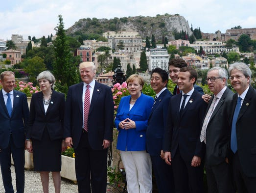 Trump joins G7 leaders for a photo at the Ancient Greek