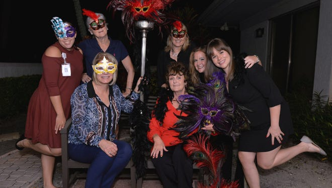 The Midnight Masquerade committee is getting ready for a night of dinner, dancing, and intrigue to benefit the Treasure Coast Hospice Foundation. Front row, from left, Cindy Hobbs and Judy Gay. Back row, Jasmine Miller, Molly McGrath, Marlene Bustillo, Charity Parsons, and Jessica Sturgeon.