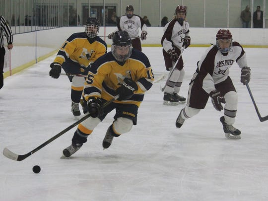 Nick Pica (15) helped Toms River North to a 5-3 win
