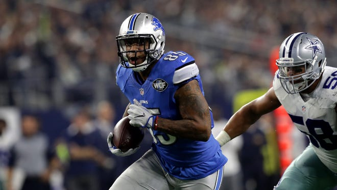 Lions tight end Eric Ebron is pursued by the Cowboys' Jack Crawford during the first half of the Lions' 42-21 loss Monday, Dec. 26, 2016 in Arlington, Texas.