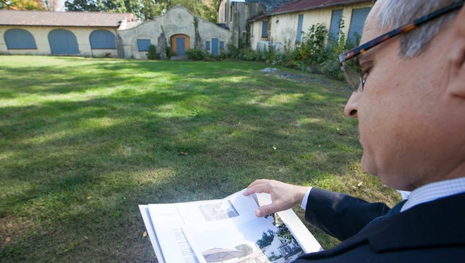 Lenord Sophrin, Wilmington's director of Planning and Development, looks at redevelopment plans. Wilmington is overhauling its website for permits and developments.