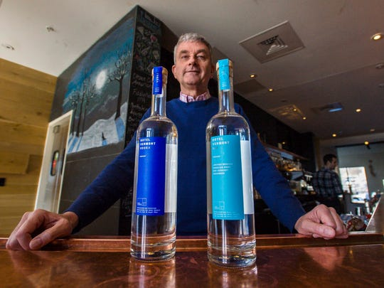 Hotel Vermont General Manager Hans van Wees with house brand vodka and gin from Silo Distillery of Windsor in Burlington on Friday, February 26, 2016.