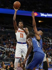 New York Knicks guard Frank Ntilikina (11) shoots over