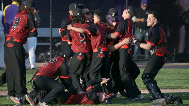 Franklin players celebrate after the final out during their Rochester City Athletic Conference baseball championship Monday. Franklin held on to win 9-8.