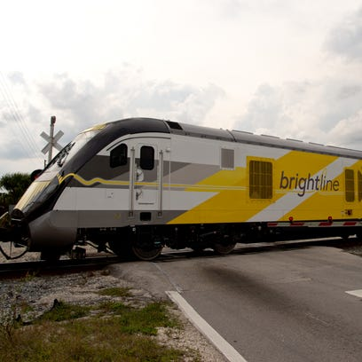 A Brightline passenger train, pulled by a Florida East