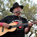 Canadian musician Neil Young performs at the Harvest the Hope concert, on a farm near Neligh, Nebraska, on Sept 27, 2014.