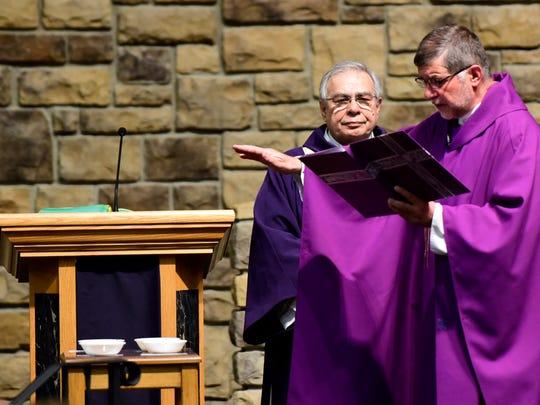 The Rev. Krzysztof Kardzis blesses the ashes on Ash Wednesday at Sacred Heart Catholic Church in Fremont.