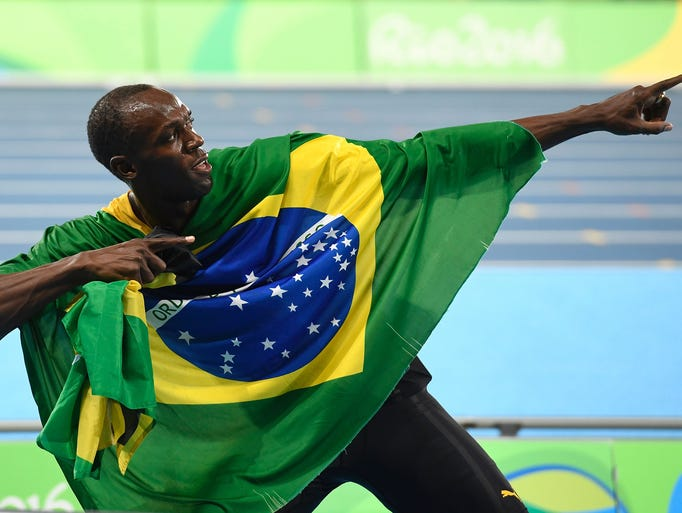 Jamaica's Usain Bolt celebrates his team's victory