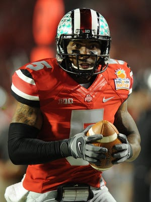 Ohio State Buckeyes quarterback Braxton Miller (5) runs in a touchdown against Clemson Tigers during the first half in the 2014 Orange Bowl college football game at Sun Life Stadium.