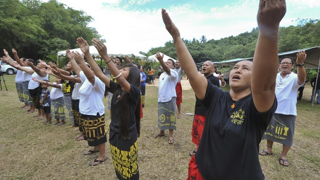 In this July 9, 2011, file photo, members of the Pa'a Taotao Tano' culture dance group perform a blessing during the annual Manenggon Memorial Service at the Manengon concentration camp in Yona.