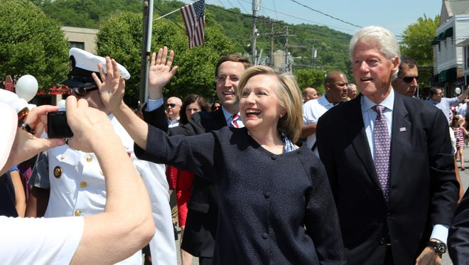 Hillary and Bill Clinton march in New Castle's Memorial Day parade in Chappaqua.