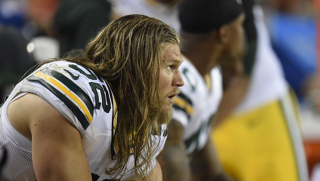 Green Bay Packers linebacker Clay Matthews shows his dejection as he sits on the bench during the final seconds  of Sunday night's game at Sports Authority Field in Denver, Colo. The Broncos defeated the Packers 29-10.