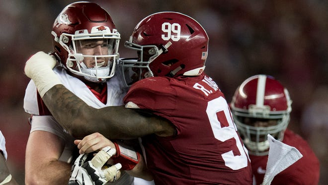 Arkansas quarterback Cole Kelley (15) is wrapped up by Alabama defensive lineman Raekwon Davis (99) in second half action at Bryant Denny Stadium in Tuscaloosa, Ala. on Saturday October 14, 2017. (Mickey Welsh / Montgomery Advertiser)