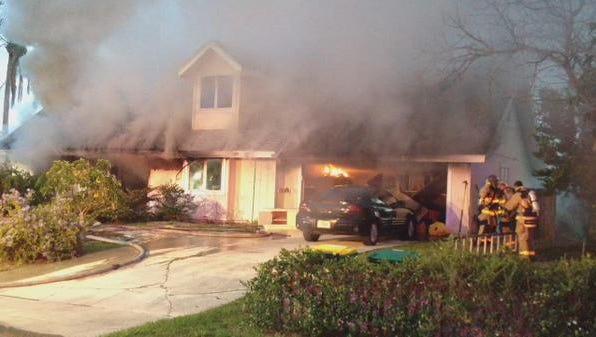 Firefighters battle a blaze at a house in Port St. John.