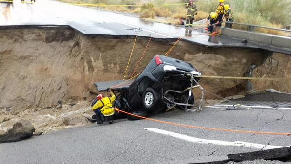 CalFire works to rescue a patient from his car after a bridge collapsed, closing I-10 in Desert Center.