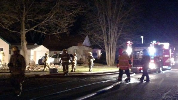 Firefighters at a house fire in Dallas Center Dec. 16.