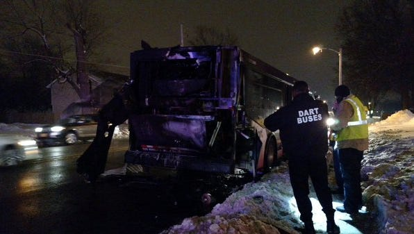 Des Moines firefighters and DART officials inspect a bus that caught fire on Merle Hay Road Dec. 30.