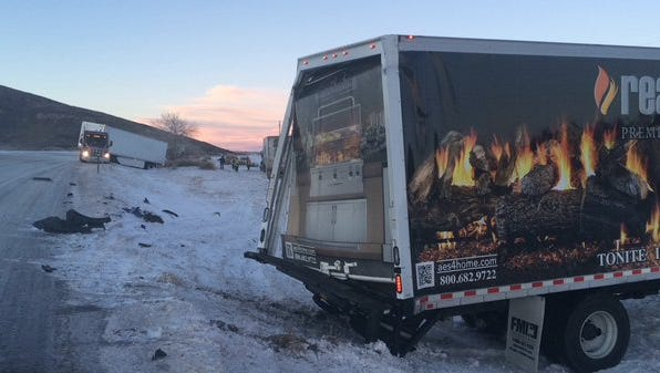 A two-truck crash on U.S. 287, just north of Ted's Place, closed the highway for at least two hours on Thursday night. No one was injured. A third truck also slid off the extremely slick road, but was not involved in the crash.