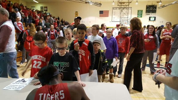 Jackie Young signs autographs after Thursday's game.