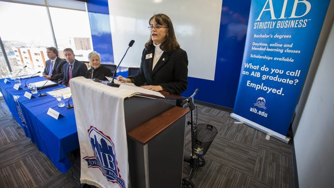 AIB President Nancy Williams makes a statement in January during the announcement of the college's merger with the University of Iowa. The AIB College of Business has seen a nearly 20 percent drop in students since that announcement.