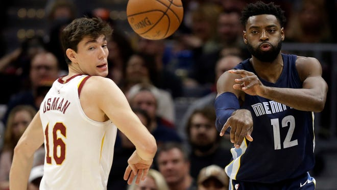 Memphis Grizzlies' Tyreke Evans (12) passes against Cleveland Cavaliers' Jose Calderon (81), from Spain, in the first half of an NBA basketball game, Saturday, Dec. 2, 2017, in Cleveland. (AP Photo/Tony Dejak)