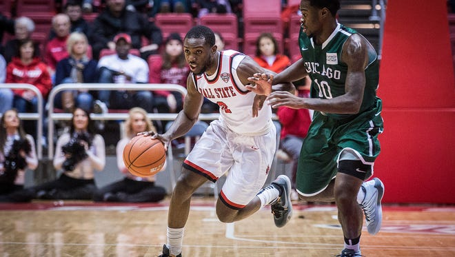 Ball State's Francis Kiapway fights past Chicago State's defense during their game at Worthen Arena Thursday, Dec. 31, 2015.