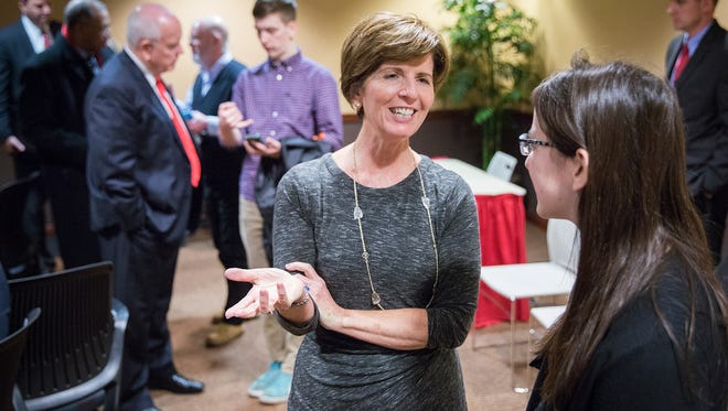 Ball State University trustess Renae Conley speaks to a student after a meeting in this file photo.