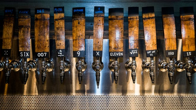 The owners of Elm Street Brewing Company and a group of contractors prepared the brewery, located at 519 N. Elm Street, for its Friday grand opening. The Elm Street Brewing Company features a 72-seat tasting room and the owners are planning on adding more space and new features in the coming months.