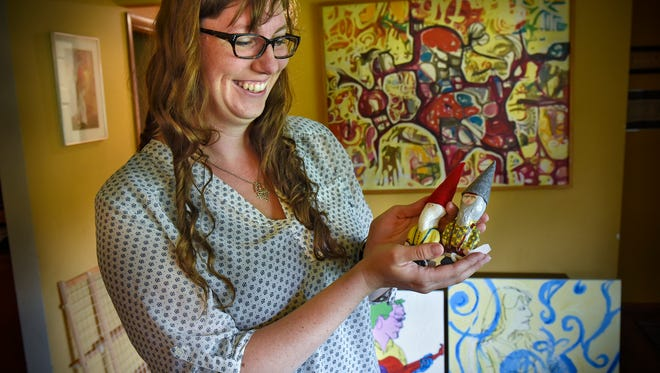 Zoe Back talks about the inspiration behind her gnome creations during an interview Tuesday, July 25, in her home in St. Cloud.