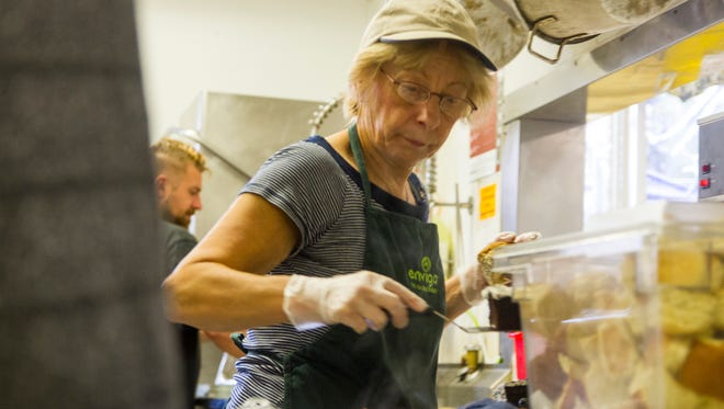 Julia Szczygier, a volunteer at Mid City Nutrition, serves food. A food packing effort will be April 21 at Port Huron High School.