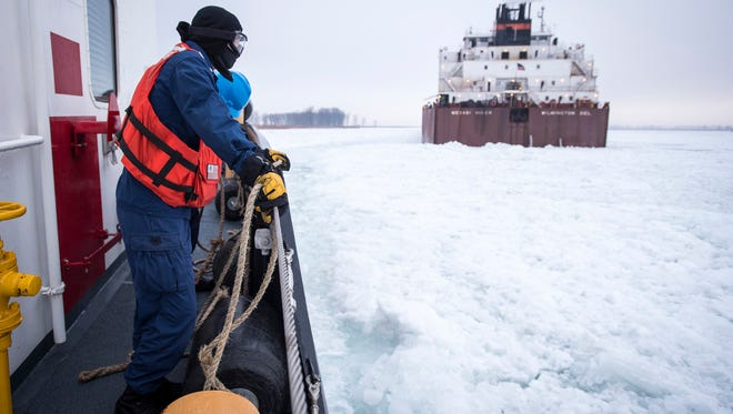 Crewmembers on the USCGC Neah Bay wait with rubber fenders while the ice cutter approaches the stuck Mesabi Miner from it's stern Jan. 10. The 1000-foot freighter became stuck in the ice in the St. Clair River, just south of Harsens Island.