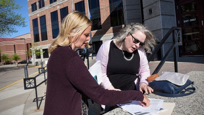 Jennifer Thelen and Sarah Sherwood prepare for a recruiting trip for foster parents at the Stearns County Administration Center Tuesday, May 15, in St. Cloud.