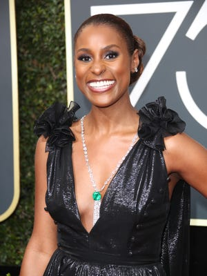 Issa Rae was practically beaming on the red carpet. Her glowing skin was completed with a brown berry lip and chignon bun.