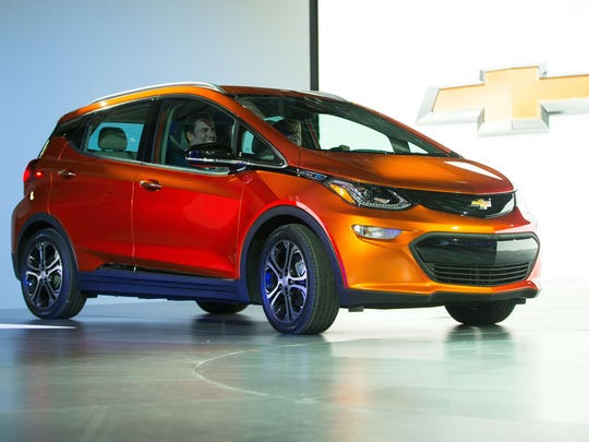 Mary Barra and Mark Reuss arrive in a 2017 Chevrolet Bolt at the 2016 North American International Auto Show in Detroit on Jan.  11, 2016.
