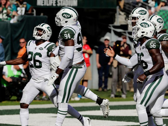 New York Jets' Kony Ealy, second from left, celebrates