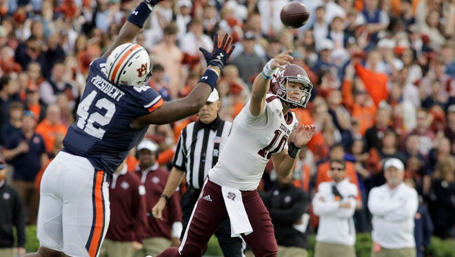 Texas A&M quarterback Kyle Allen (1) throws a pass against Auburn defensive lineman Gimel President in the Aggies' 41-38 win Saturday. Allen threw for 277 yards and four touchdowns.