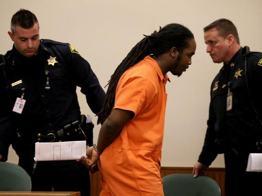 Lydell Strickland is led back to prison after his sentencing.