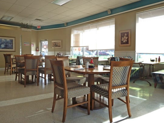 Tables and booths inside Frontier Family Restaurant