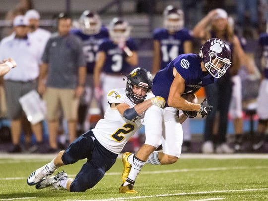 Sevier County's Coli Russell is grabbed by Seymour's