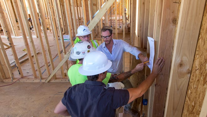 Work is well under way on the new eight-unit MZ condominiums northeast of Camelback and Scottsdale roads. The project, scheduled to be completed in June, is representative of a surge of new construction in the city.