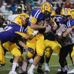 Byrd's Cole Albritton (70) runs with the ball after Fair Park fumbled and ran for a touchdown during the jamboree with Fair Park.