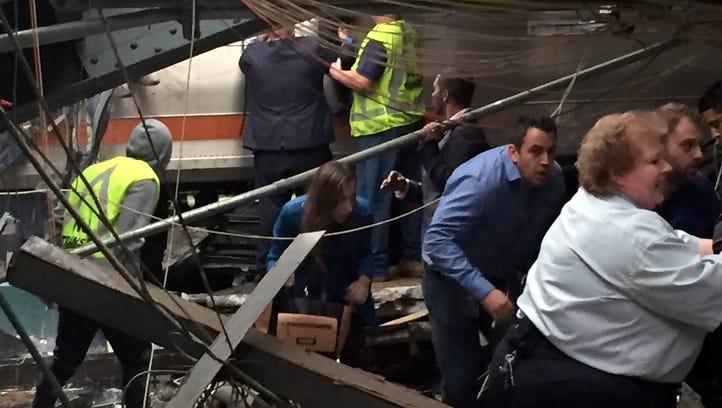 HOBOKEN, NJ - SEPTEMBER 29:  Passengers rush to safety