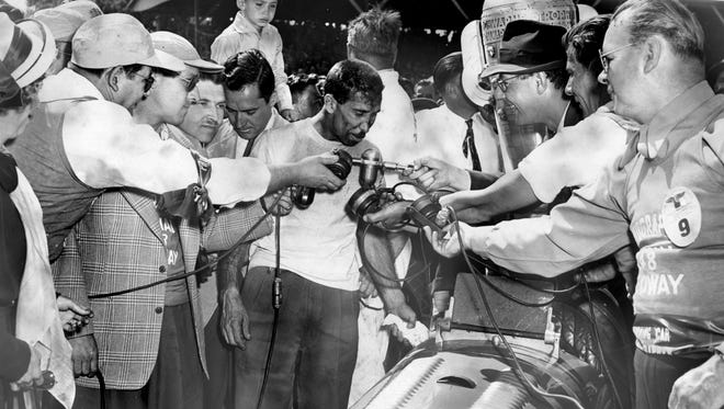 Mauri Rose gets interviewed after winning the Indianapolis 500 in 1948. Indianapolis Star file photo