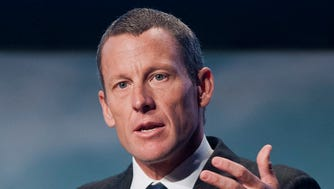This file photo from 2012 shows Lance Armstrong speaking to delegates at the World Cancer Congress in Montreal.