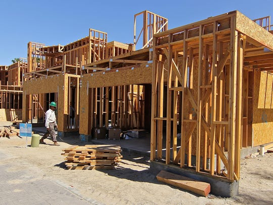 A worker walks around the construction site of Sol Palm Springs, one of the new home developments popping up around the Coachella Valley. Realtors suggest today's real estate market is more sustainable than that seen just before the recession hit.