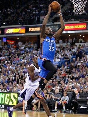 Oklahoma City Thunder forward Kevin Durant (35) prepares to dunk the ball against the Sacramento Kings in the third quarter at Sleep Train Arena.