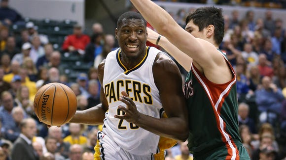 Pacer Ian Mahinmi drives past Buck Ersan Ilyasova in the first half. Indiana hosted Milwaukee at Bankers Life Fieldhouse on Tuesday, November 4, 2014.